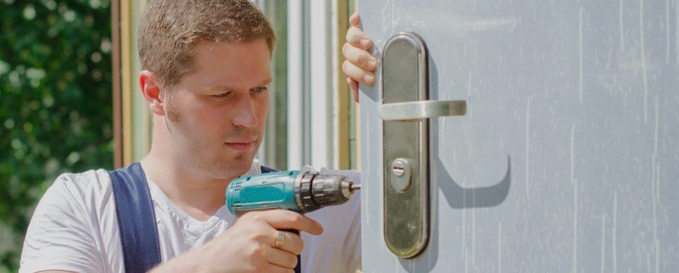 Residential Locksmith Technician At Work